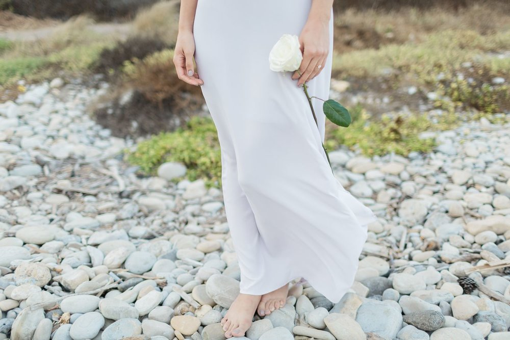 bride holding white rose engagement photos