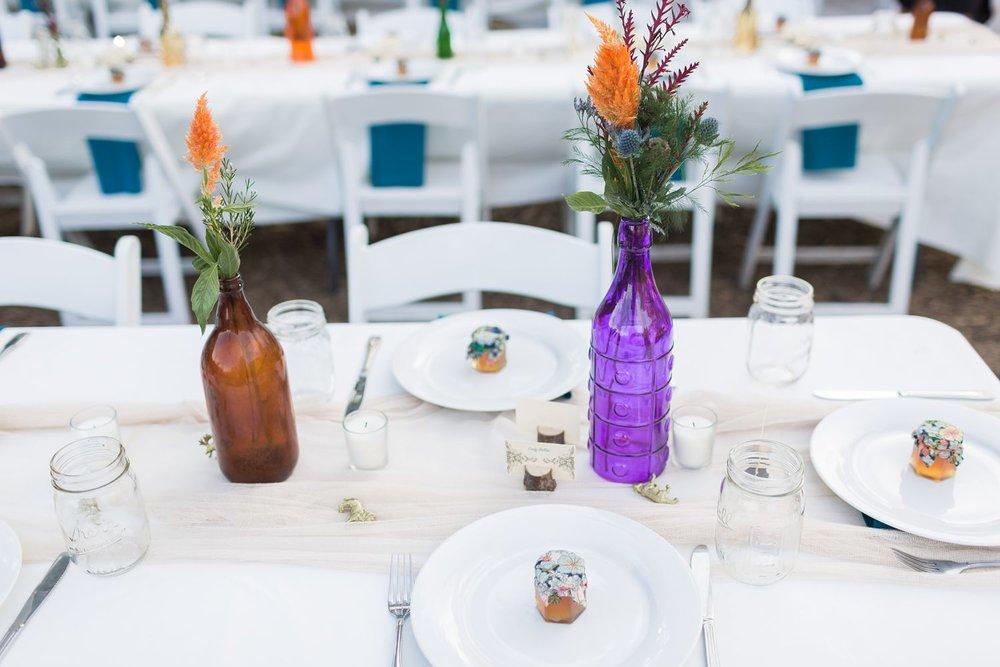 flowers in bottles wedding reception centerpieces