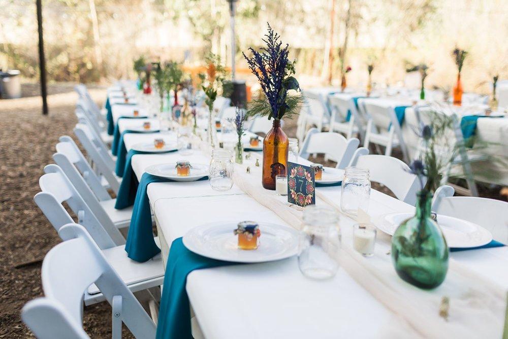 blue napkins on white wedding reception table