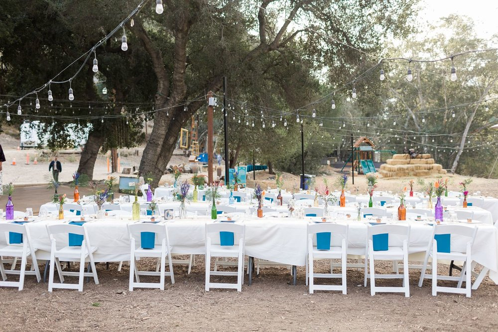 white chairs wedding reception reptacular ranch