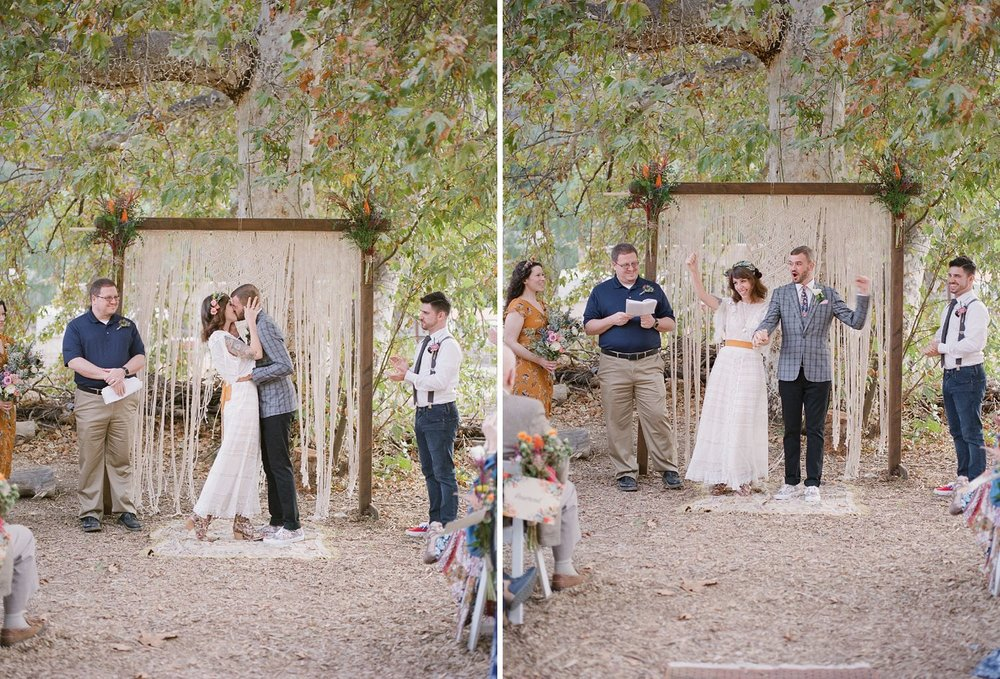 bride and groom first kiss at reptacular ranch wedding