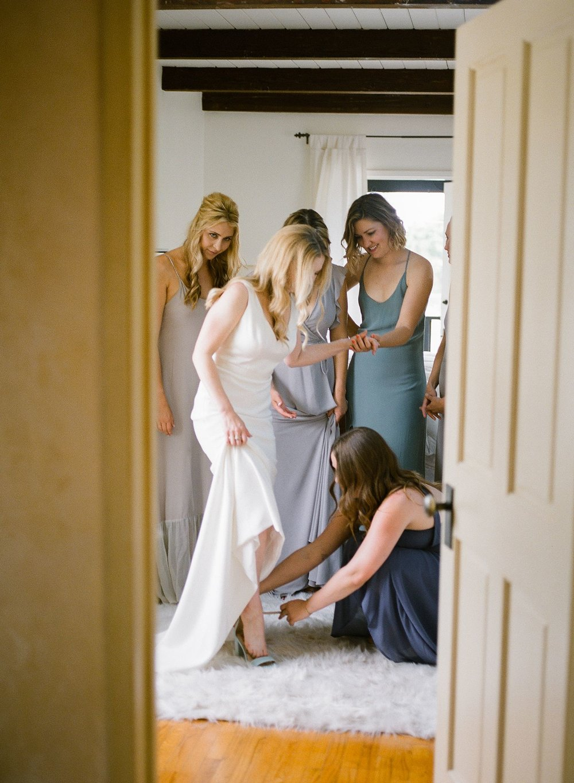 bride putting shoes on santa barbara wedding photo