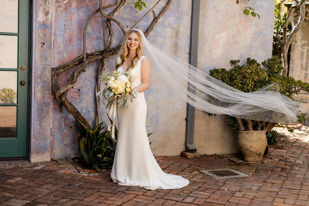 bride with long veil casa de la guerra wedding
