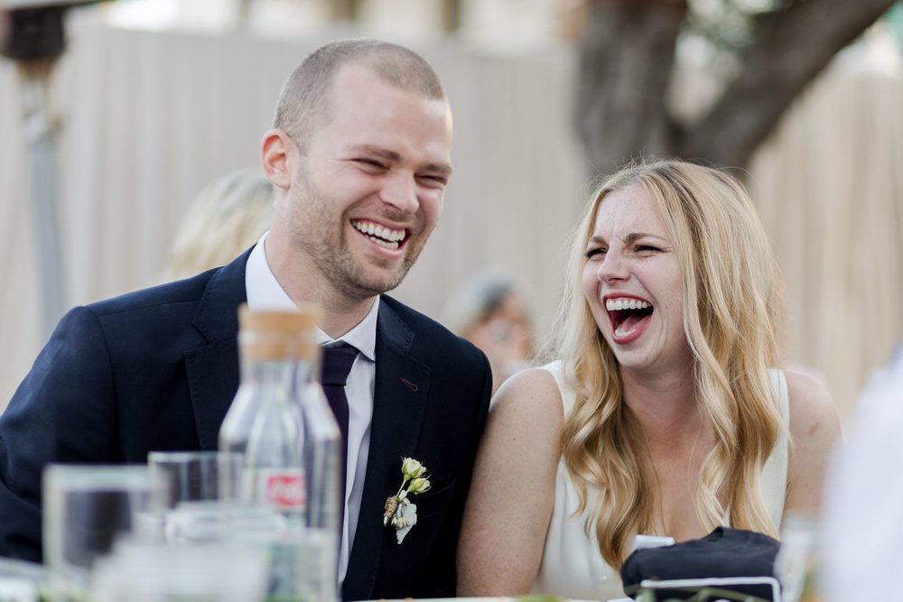 bride and groom laughing santa barbara