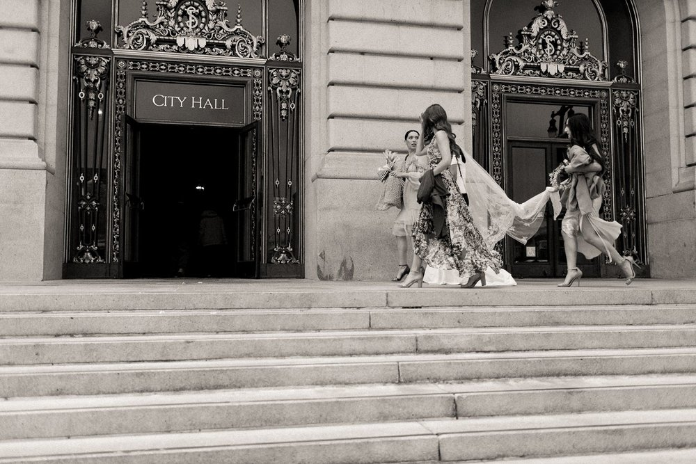 bridal party enters city hall for san francisco wedding