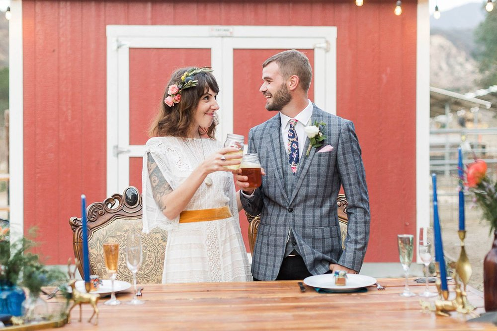 bride and groom toast at reptacular ranch wedding