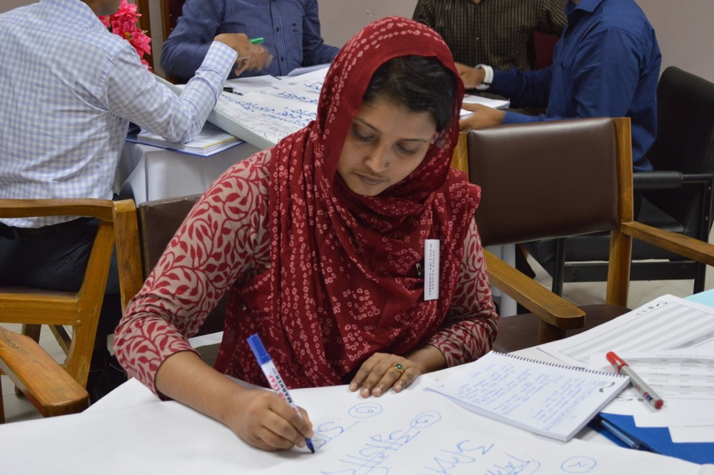 A participant in Dhaka is preparing to present her group's work, September, 2013
