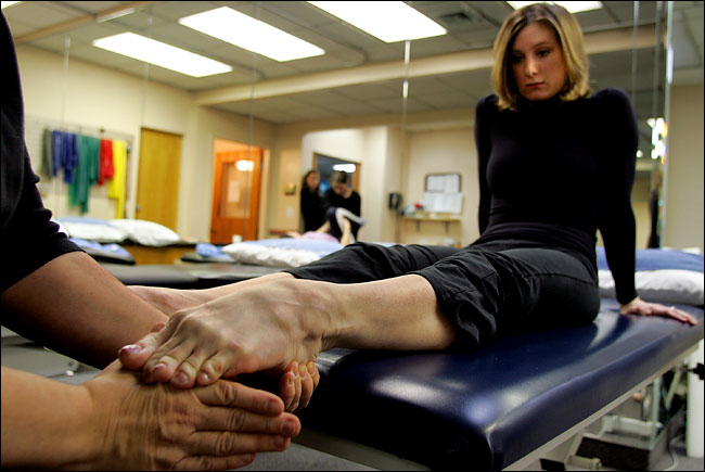 pictured - NYCB dancer receiving treatment for her foot injury