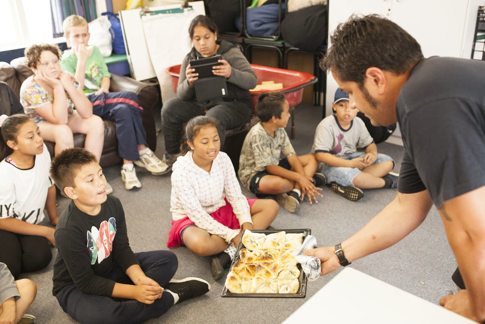 Mike Tamepo at Randwick Primary showing the kids what they cooked