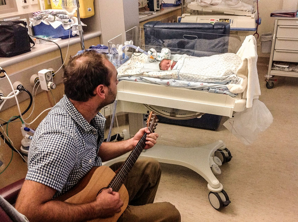 Oscar's dad Richie could play his guitar softly to Oscar while he was relaxing in the incubator.