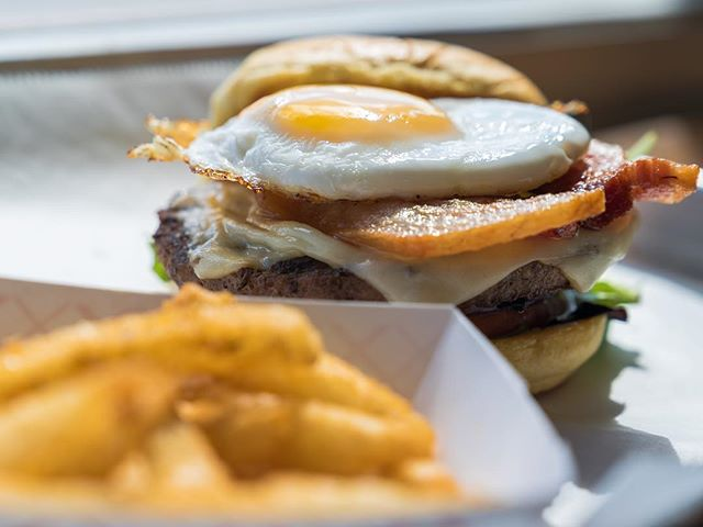 Weekend mode! Come and take a bite of the Doggy Burger, one of our newest creations that won't disappoint!  #cheese #burger #thickcut #bacon #friedegg #gourmet #concept  #eeeeeats #localeats #miami #littlehaiti #foodie #video #foodporn #potatorolls