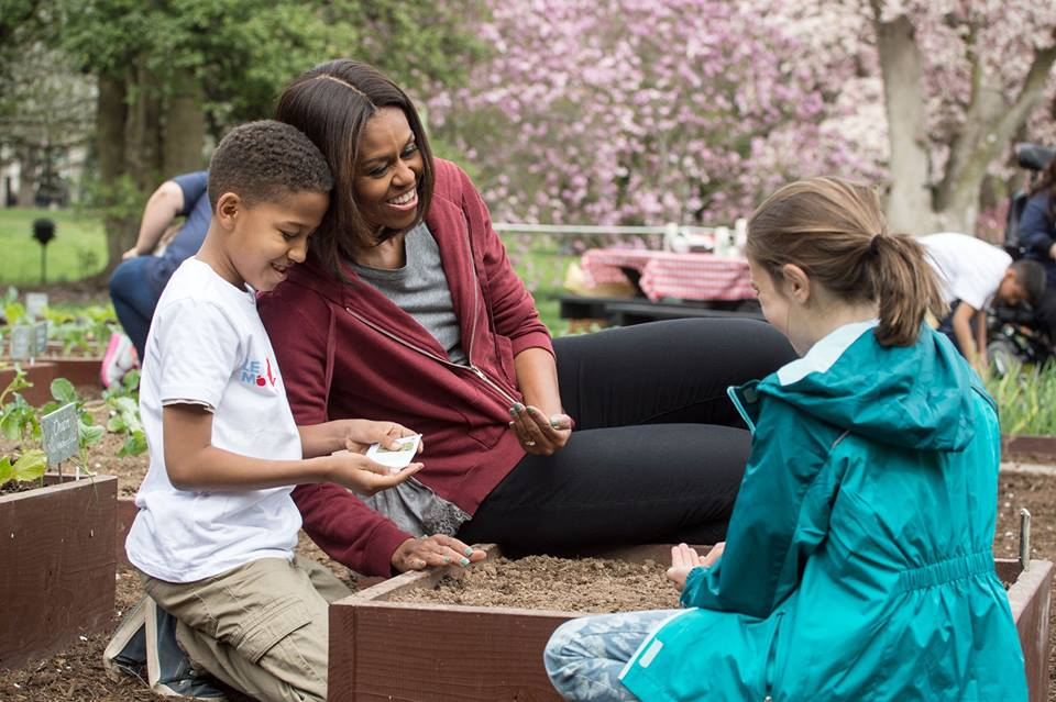 Michelle Obama sowing seeds in the White House Garden pc: Let's Move! Facebook Page