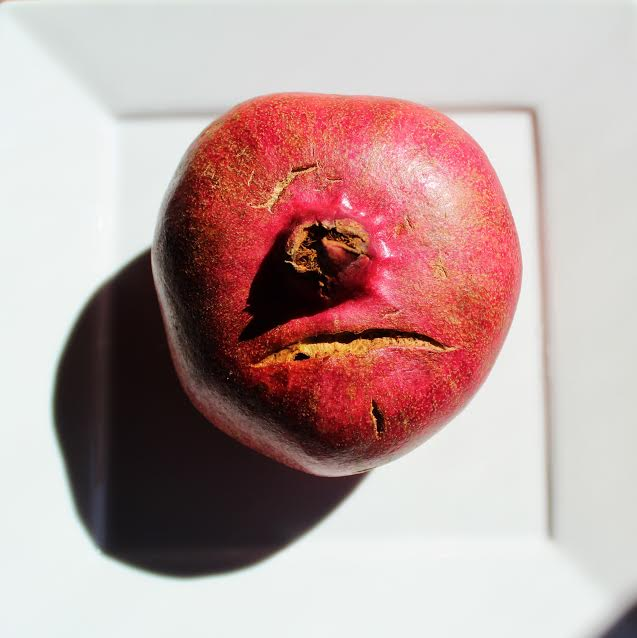 """Pomegranate Frowny Face"""