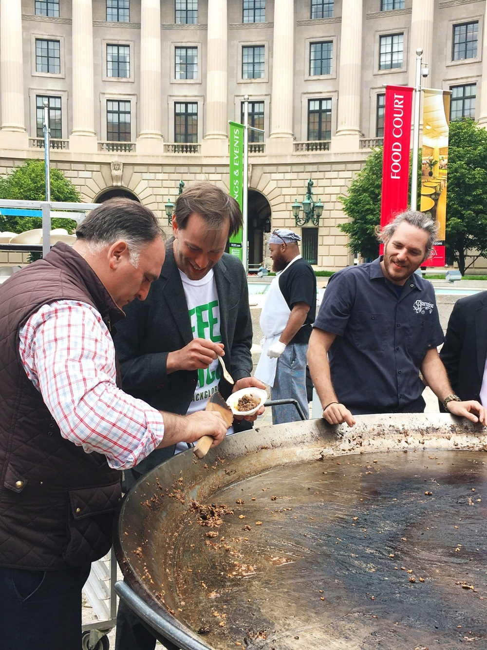 Chef José Andrés (Think Food Group), Tristram Stuart (Feedback) & Chef Spike finish up the last of the paella at Feeding the 5,000 D.C.