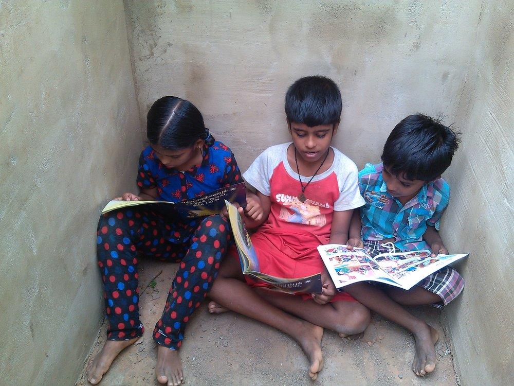 Children with Gospel book.jpg
