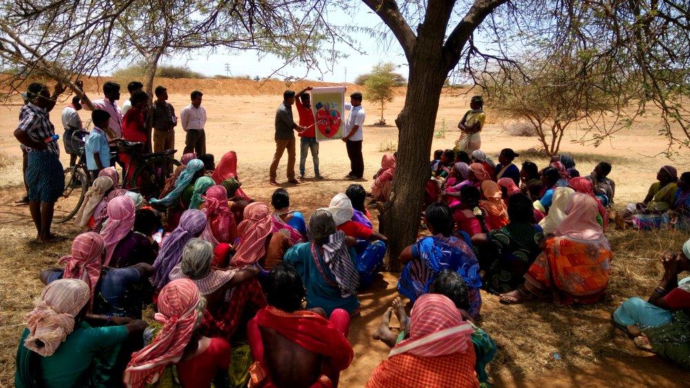Gospel with 100 days labourers.JPG