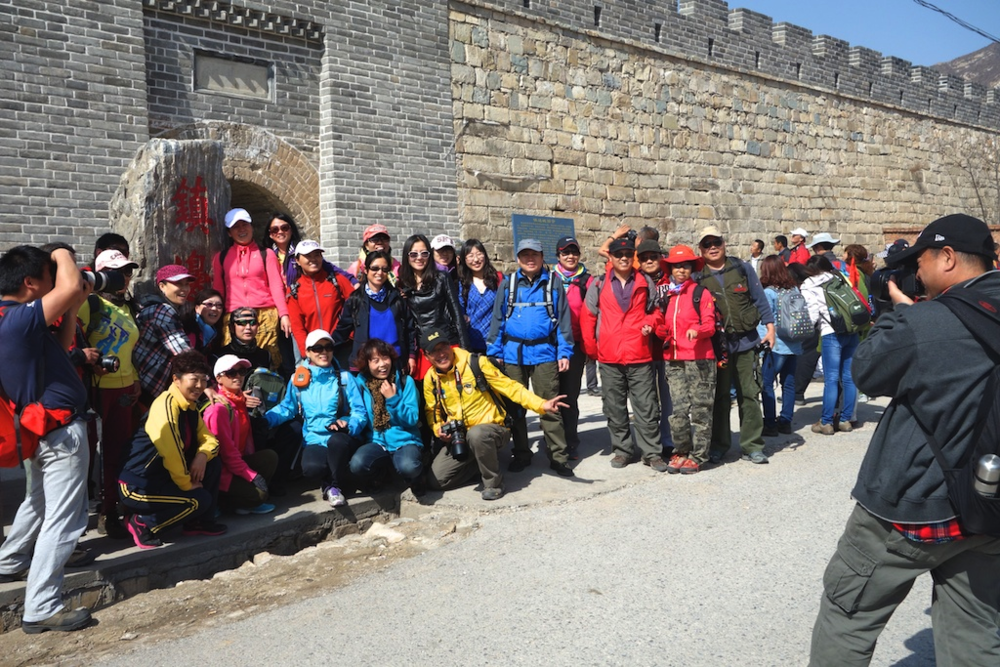 In winter, the village had few visitors. In spring and summer,  Chinese tourists, resplendent in the latest hiking gear, would stop at the village gate before walking off to start a climb to the Great Wall. Very few ever went into the village.