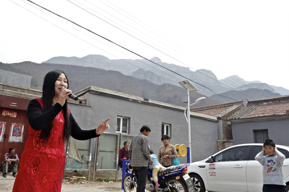 One of the two women who called themselves the   Yunsan Sister Troupe. Their business card said:   Items of service:     wedding ceremonies, removal to a new house or shop opening, birthday parties, business shows, stage lighting, photography and cameras.
