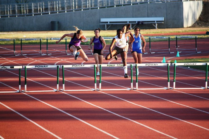 Amber Rosario in the 300m hurdles in High School