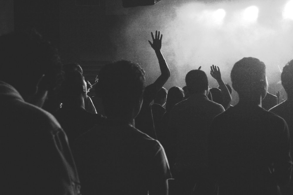A crowd at a gig. Image accompanies an article about how to make the most out of a support slot.