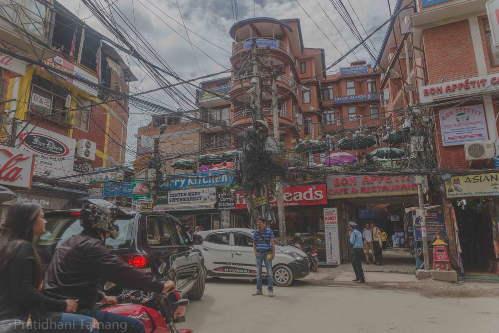 Thamel is probably the first place you are going to arrive at. The hustle is real in this place. It is packed with fake trekking gear shops, restaurants and loads of wires liek in the picture.