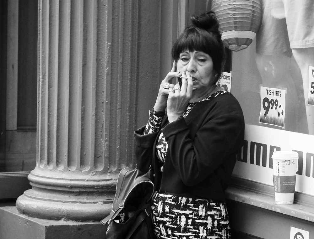 Woman+with+cig+and+phone.jpg