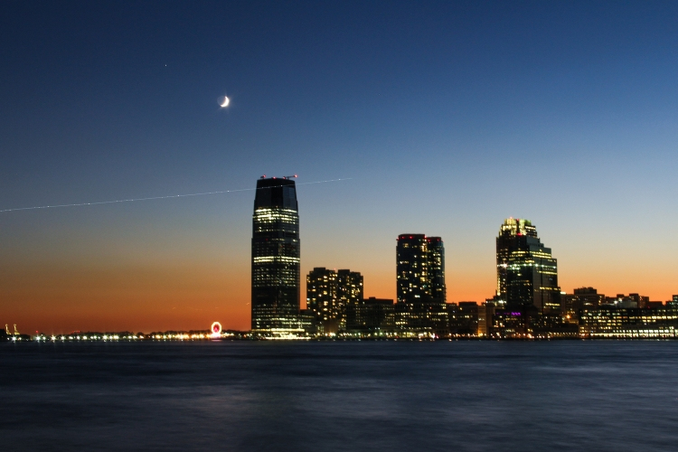 Jersey City. The plane light trail was captured with a 10 second shutter speed.