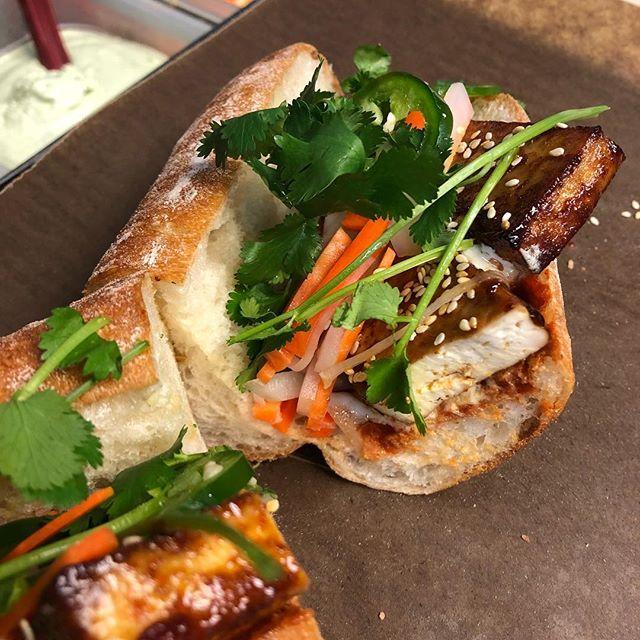 BBQ tofu sandwich! BBQ tofu, toasted sesame seeds, pickled daikon and carrot, cilantro, fresh jalapeño, garlic aioli, sriracha, on a fresh baked French roll