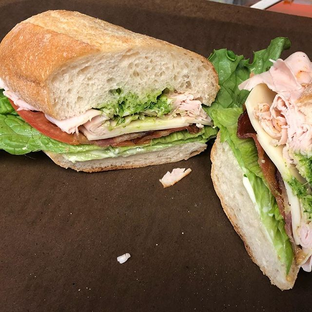 Green harissa, Turkey, bacon, provolone, tomato, mayo, and lettuce, on a fresh baked French roll! (Pictured) Or! Try the vegan version: green harissa, roasted red pepper salami, avocado, red onion, garlic aioli, and lettuce on a fresh baked French roll.