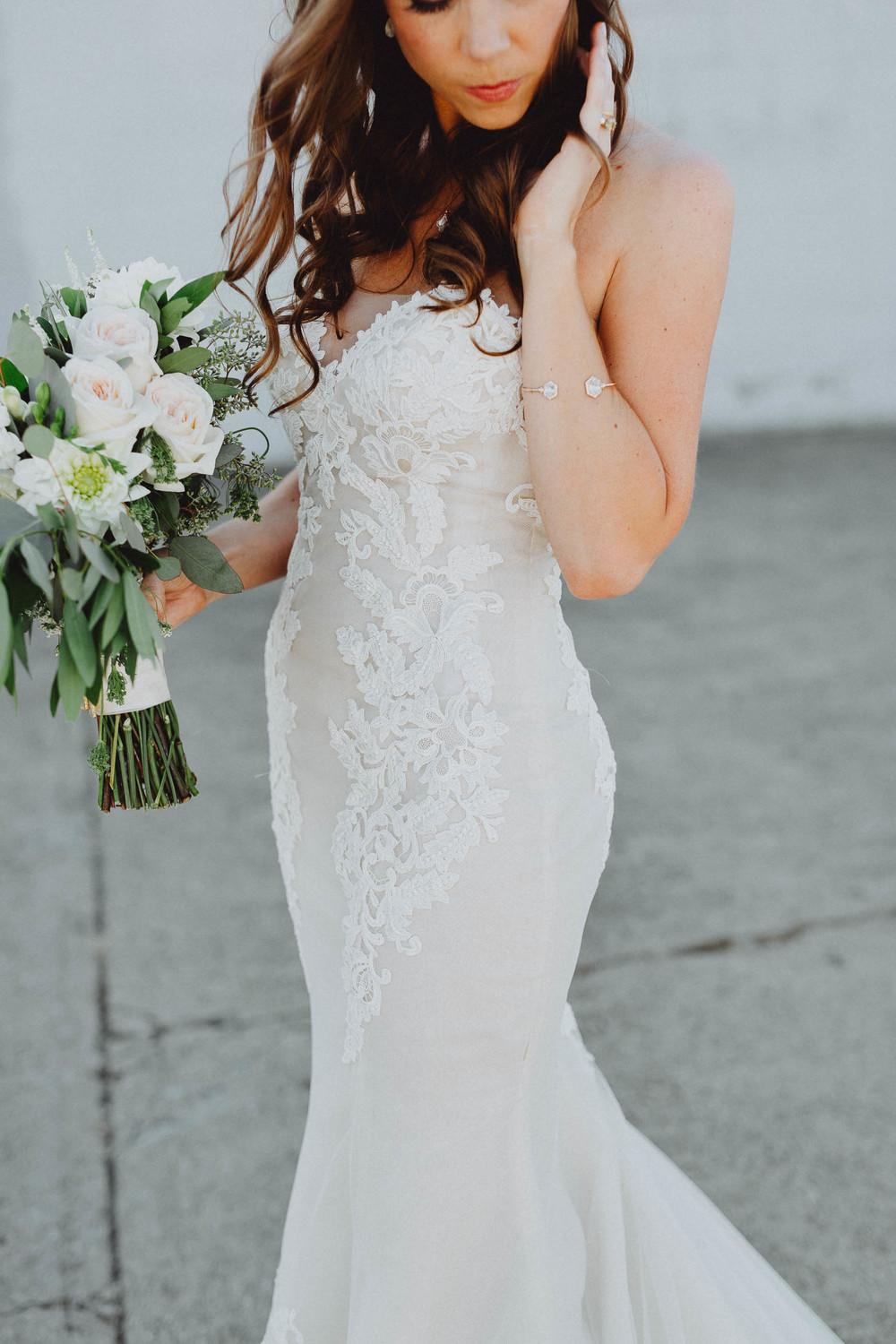 Gorgeous bride wearing a lace wedding dress designed by Ines Di Santo.