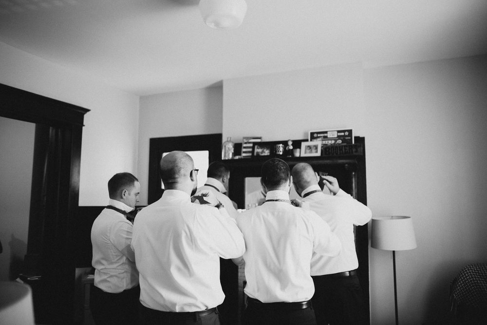 Groomsmen Tie Bow Ties Together