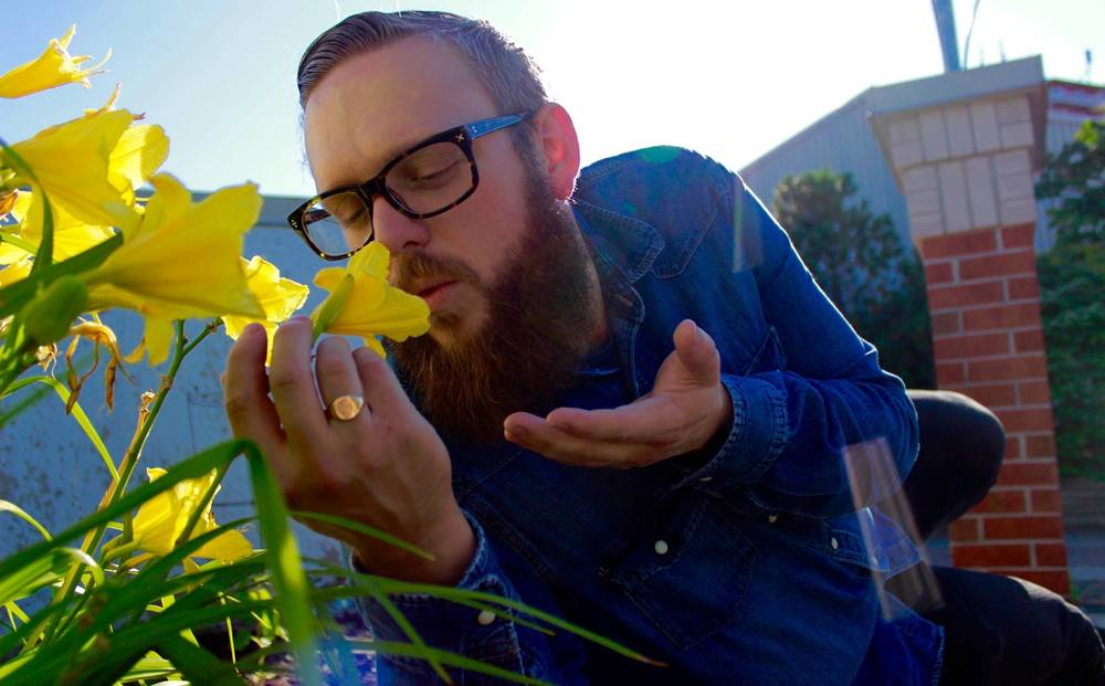 Pictured: Greg whispering sweet nothings into that flower. What we wouldn't give to be that flower, amirite?