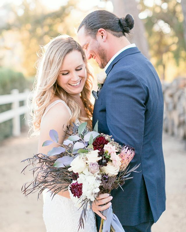 Kicking off the new year with this beautiful wedding on the blog ✨ I still can't get enough of this dress and these flowers! Congrats @kcadreau + @realbadcad 🥂Wedding coordinator: @candice_engagedevents // Venue: @brookviewranch // Florals: Elegant Earth // Hair + Makeup: @cheektocheekartistry // Catering: @24carrotscatering 🌞 . . . . #daybreakanddusk #daybreakandduskphoto #gooutside #losangelesphotographer #losangelesweddingphotographer #lawedding #laweddingphotographer #laweddingphotography #losangelesweddingphotography #weddingphotographer #weddingdress #realwedding #wildheart #modernbride #weddingphotography #weddingday #weddingplanning #weddings #lovebirds #weddingdress #weddingtime #brookviewranch #makeportraits #soloverly #engaged #brides #realbride #weddingdress