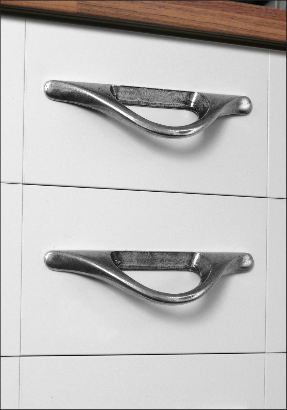 Sculptural Manzoni drawer pulls from Ashley Norton.