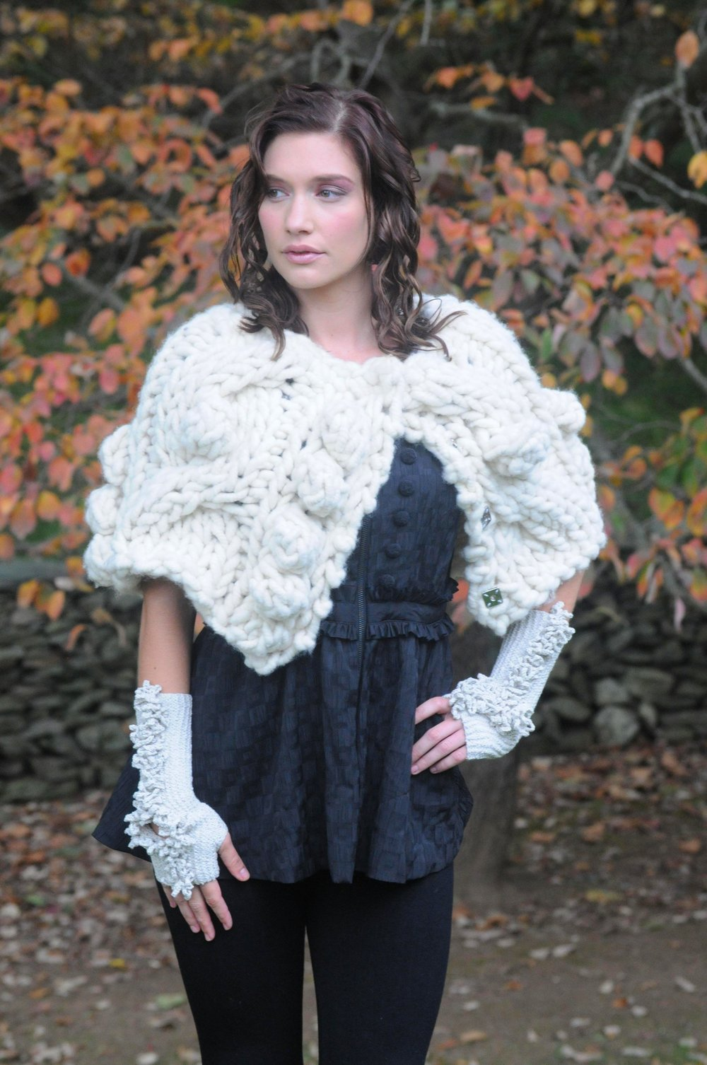 Remie is a sweet little mini, snap front cape that you will want to wear all of the time.  Designed by Terri Rosenthal   with a collaboration with Becca Smith of The BagSmith     Hard copy pattern, PDF, Kits and finished garment. Seen in Big Bump yarn by The BagSmith.