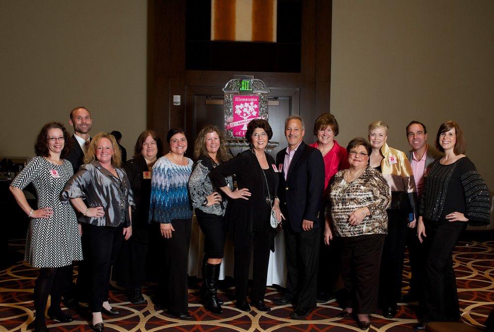 The Blossoms of Hope Board of Directors at the Diamond Casino Night in November 2015: Christie Lassen, Sean Harbaugh, Beth Ditman, Becky Mangus, Anita Broccolino, Michelle Wildman, Regina Ford, Joe Barbera, Mimi O'Donnell, Tina Broccolino, Sherri Collins-Witzke, Pete Mangione, and Blossoms of Hope Administrative Coordinator, Lene McCollum.  Not in photo: Wayne Johnson and Janet Robey Photo courtesy of Pam Long Photography
