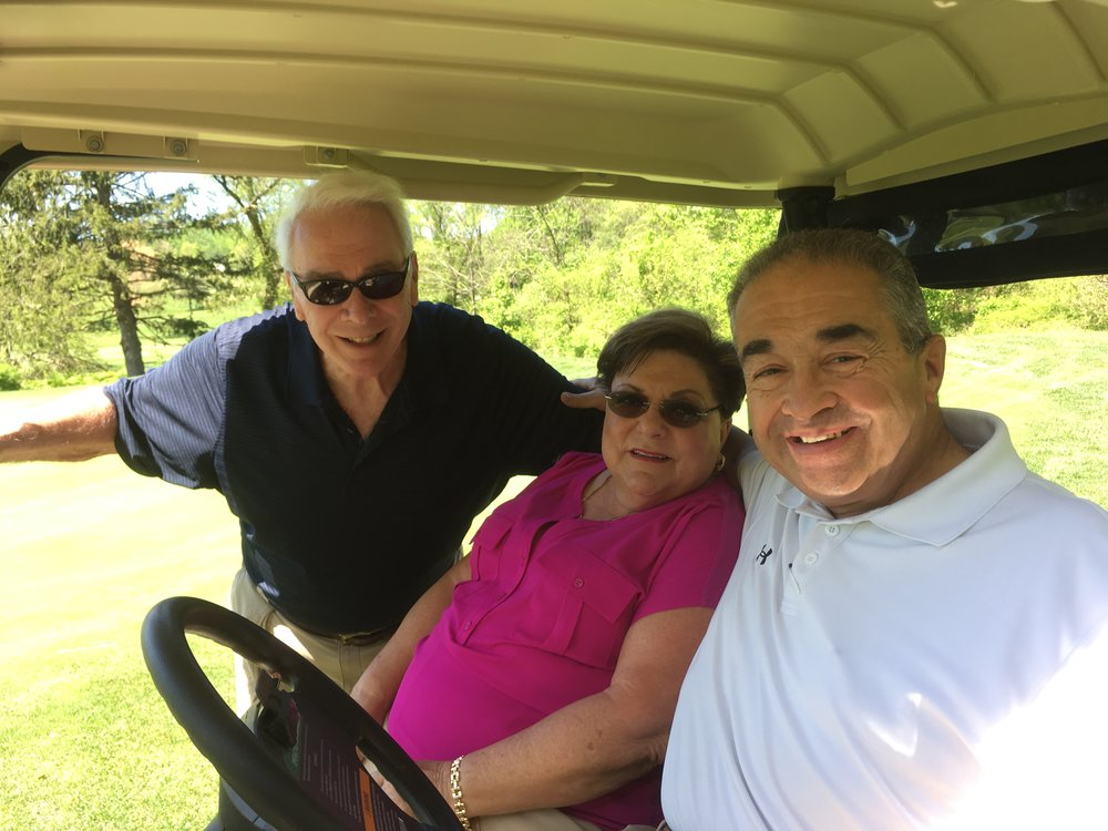 Jim Robey, Board member Tina Broccolino and Vic Broccolino overseeing the hole in one competition at our 2017 Pink Greens Golf Tournament.