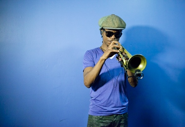 ~Rolling Stone Magazine     Macklemore's trumpet player,   Owuor Arunga, warms up backstage.