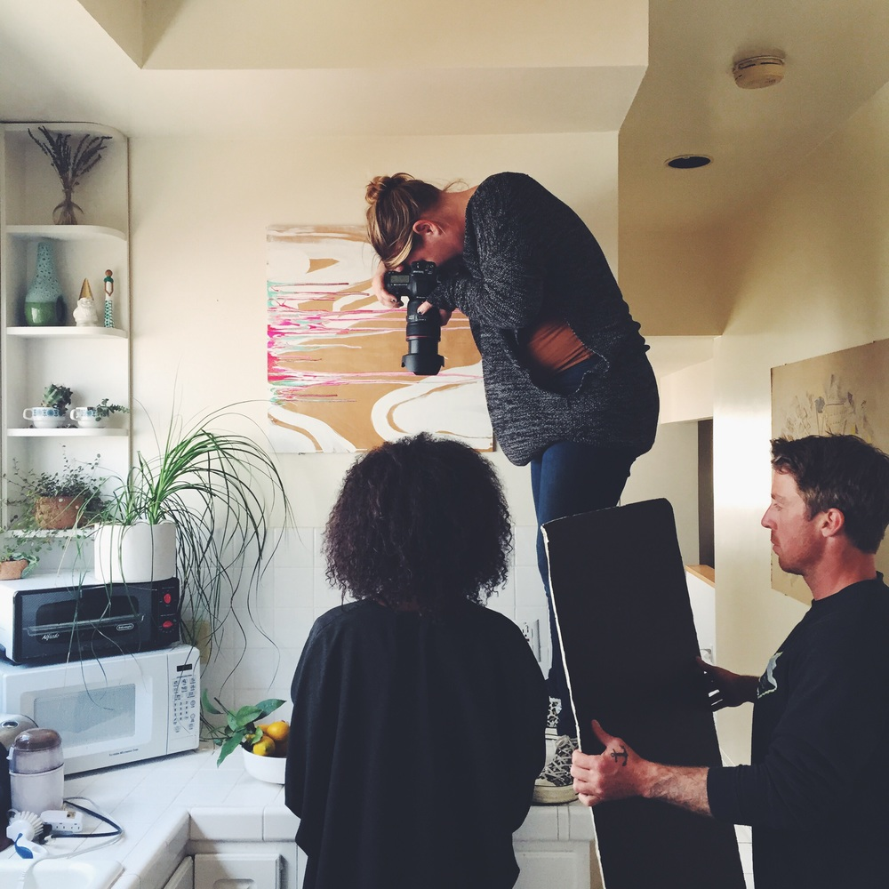 Eva shooting, Brian assisting in the kitchen