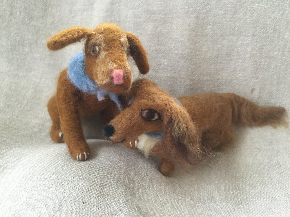 A vizsla and a long-haired dachshund modeled after a friend's granddogs. Needle felted and 6 and 4 inches tall.
