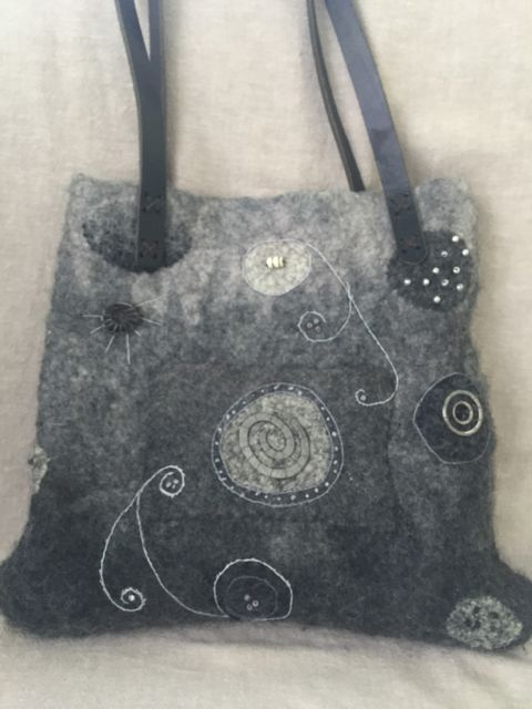 Wet felted tote embellished with beads and embroidery.