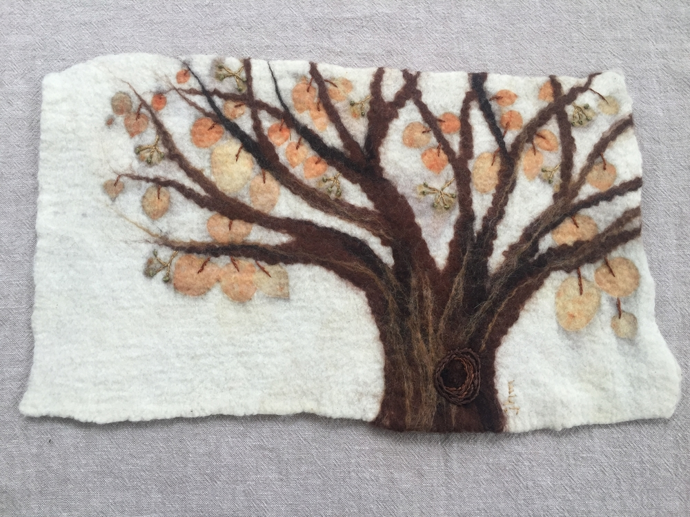 Wet felted, then eco printed with eucalyptus.