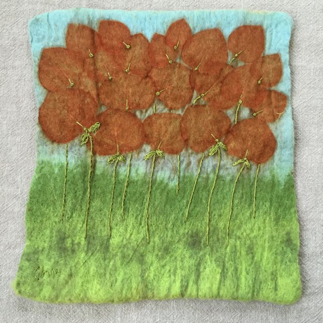 Wet fe;ted. eco printed wall hanging, embellished with embroidery.