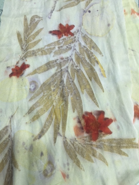 Print of yellow coreopsis blossom and grevillea on silk jersey.