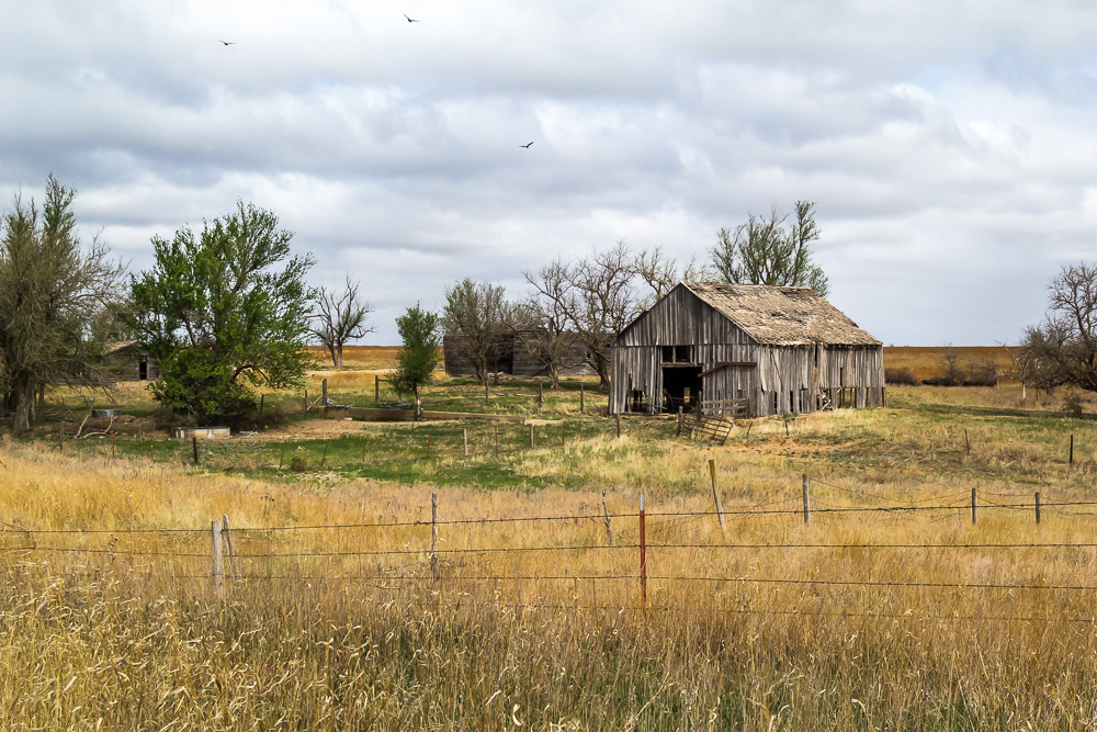 An old Kansas barn sits on the property of this abandoned farm in Comanche county, Kansas