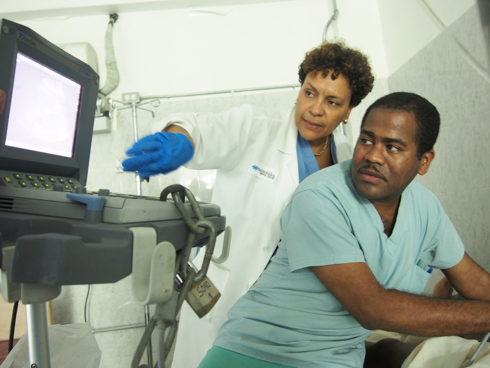 Haitian resident being guided through a high-risk OB ultrasound