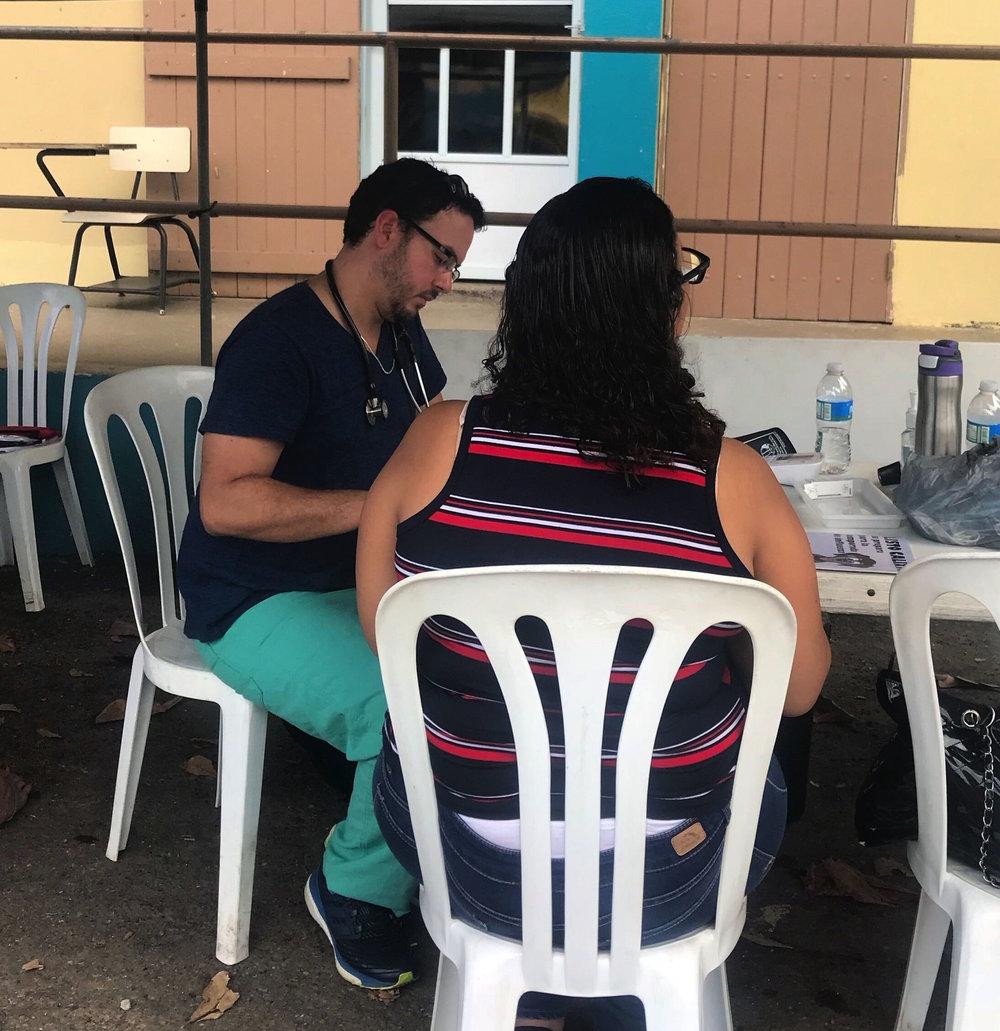 Puerto Rican physician Manuel Betancourt triages patients