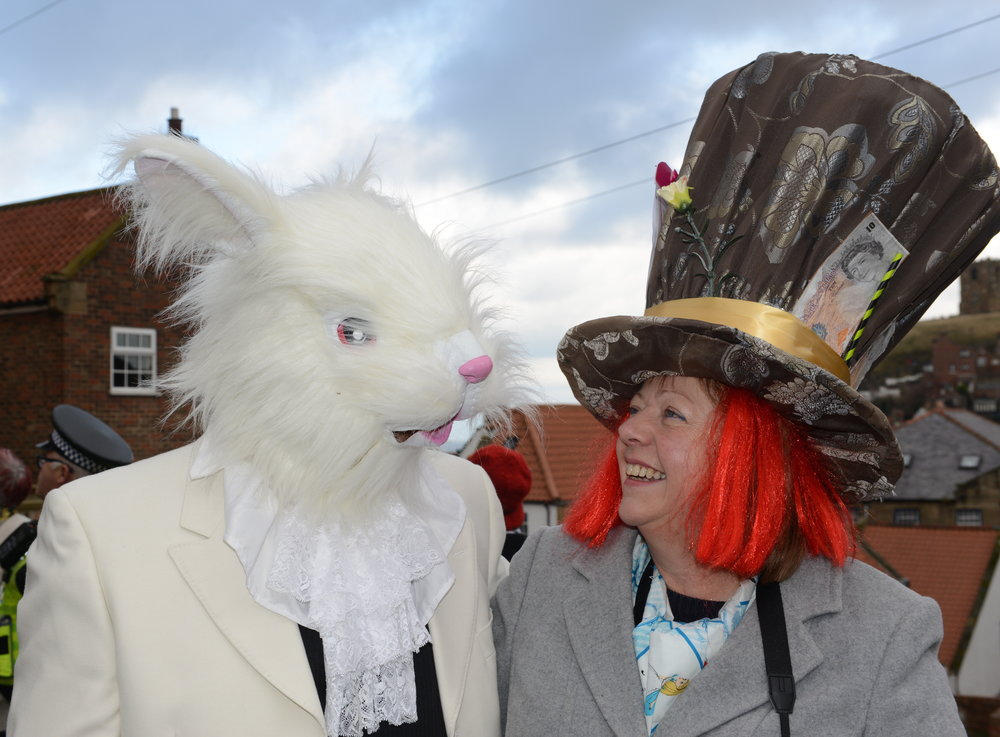 The White Rabbit and the Mad Hatter enjoying the fun.