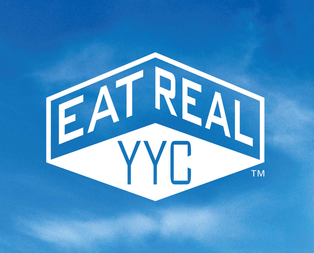 Eat Real YYC logo sky background