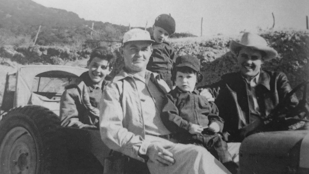 A Jeep Excursion: Clint with Lincoln, Doyle (standing), David, and Charlie at the wheel